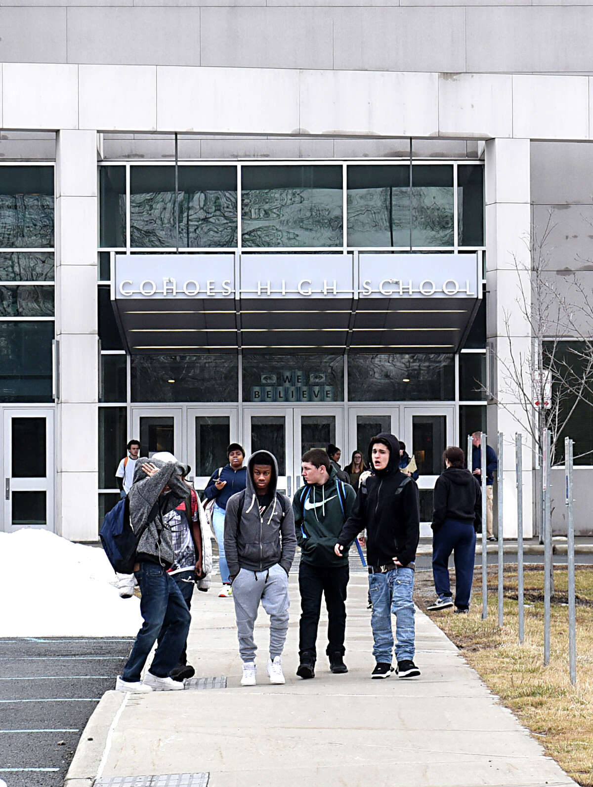 Students walk home from Cohoes High School on Monday, March 27, 2017 in Cohoes, N.Y. For the first time in Cohoes' history, students may soon be riding the bus to school. All students in the district walk or depend on rides from family and friends to get to school but the district is weighing the possibility of giving out bus passes that would let students take CDTA buses to school. ( Lori Van Buren / Times Union)