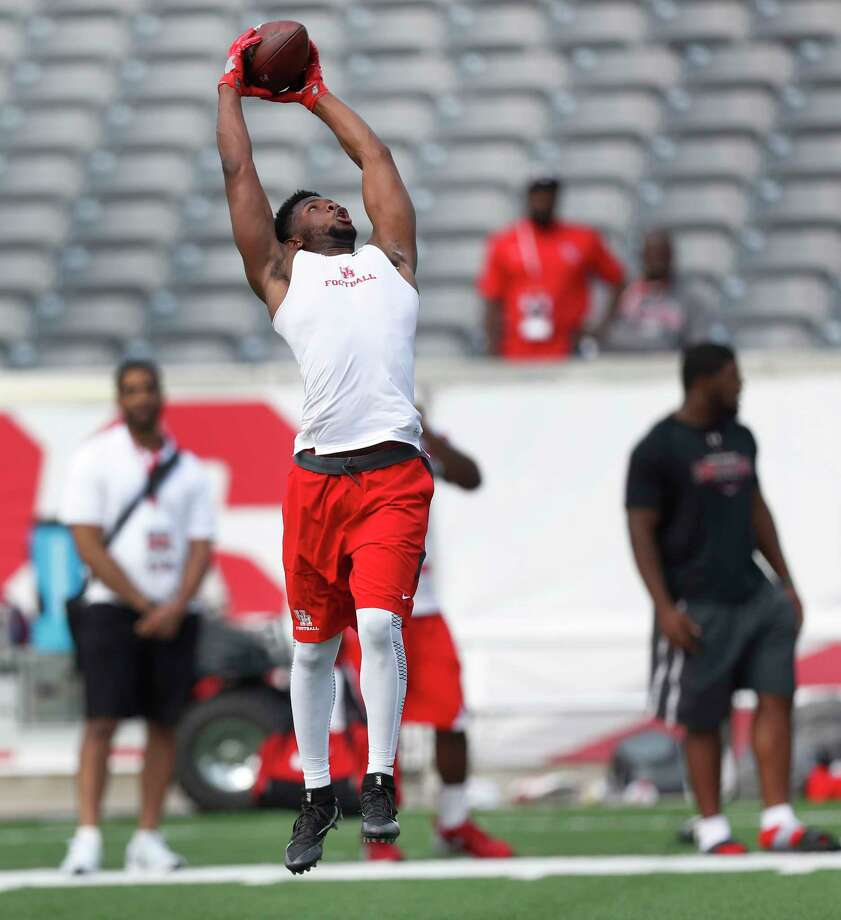 Greg Ward, Jr. leaps up to catch a pass at the University of Houston Pro Day, Monday, March 27, 2017, in Houston. Photo: Karen Warren, Houston Chronicle / 2017 Houston Chronicle