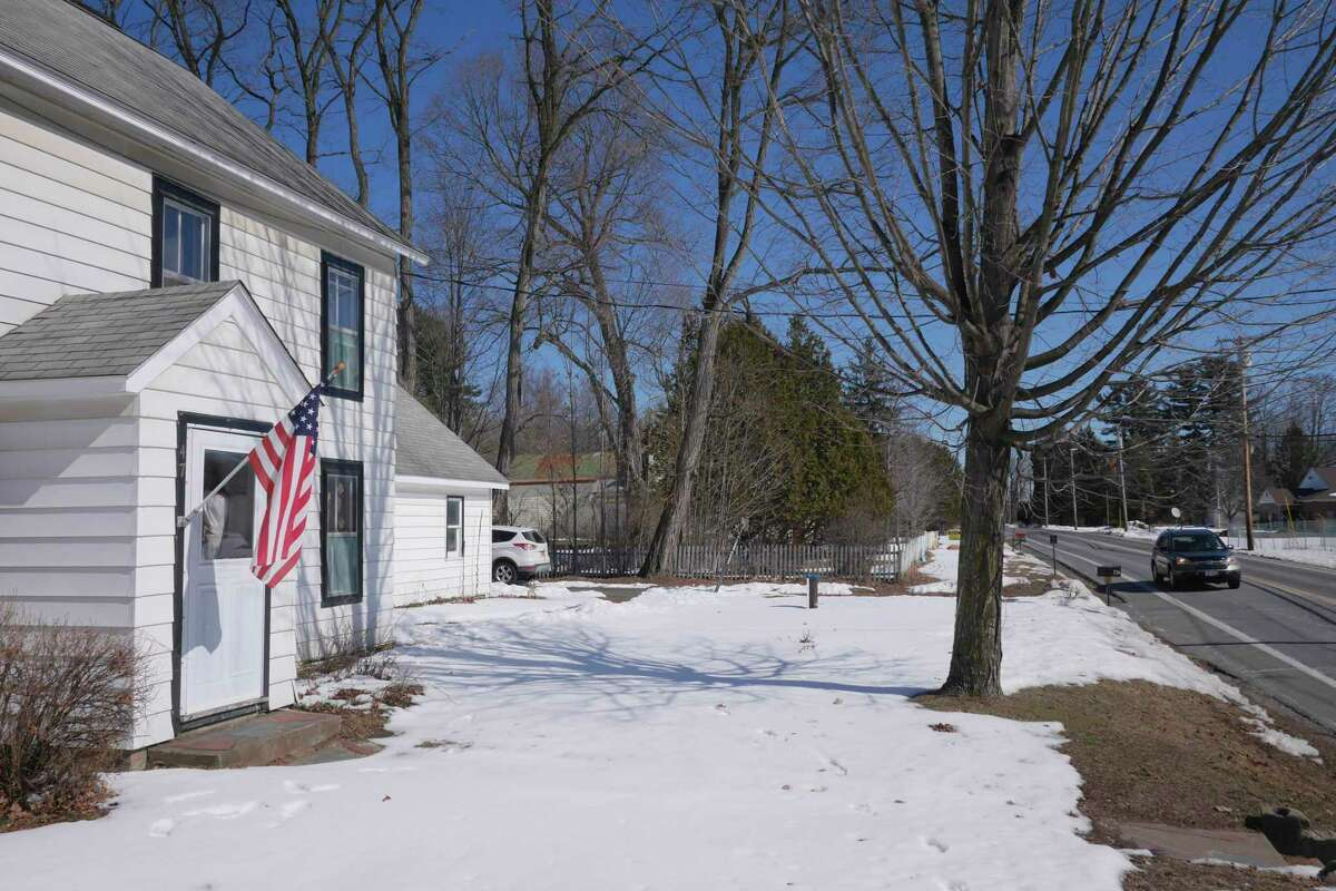 A view of the home of Dana and Jeremy Parzych on Thursday, March 23, 2017, in Gansevoort, N.Y. The couple plans to try and sell their home, which they purchased in February of 2016 because the neighboring property, seen in the background, is where a Dollar General store will be built. (Paul Buckowski / Times Union)