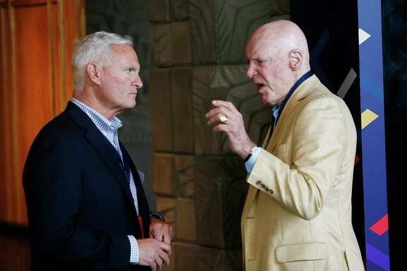 The owners of the teams involved in the Brock Osweiler deal - the Browns' Jimmy Haslam, left, and Bob McNair - talk at the NFL meetings.