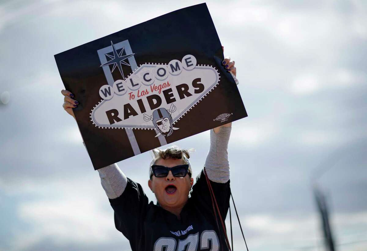 Labor union member Geraldine Lacy celebrates Monday, March 27, 2017, in Las Vegas. NFL team owners approved the move of the Raiders to Las Vegas in a vote at an NFL football annual meeting in Phoenix. (AP Photo/John Locher) ORG XMIT: NVJL104