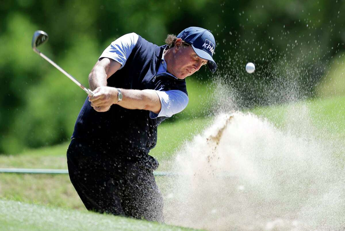 Phil Mickelson plays a shot from a bunker Saturday at the Dell Technologies Match Play golf tournament in Austin. Though he isn't accused of wrongdoing, Mickelson has been mentioned at an insider trading trial in New York.