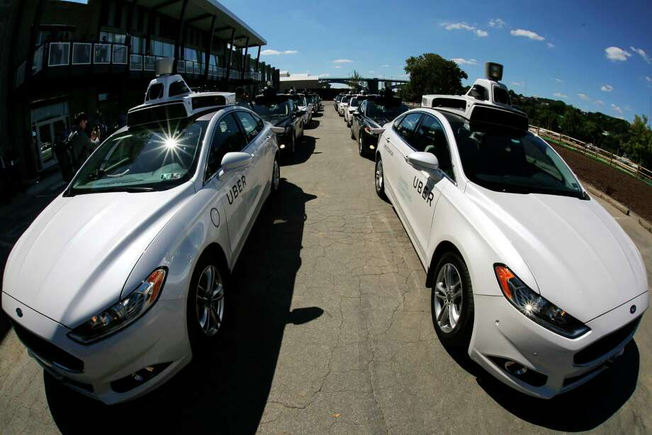 FILE - In this Monday, Sept. 12, 2016, photo, a group of self-driving Uber vehicles position themselves to take journalists on rides during a media preview at Uber's Advanced Technologies Center in Pittsburgh. On Monday, March 27, 2017, Uber said it is resuming its self-driving car program in Arizona and Pittsburgh after it was suspended following a crash over the weekend. The company had also grounded self-driving cars in San Francisco over the weekend but they resumed operating earlier on Monday. The company said that it paused the operations over the weekend to better understand what happened in Arizona, but feels confident in returning the cars to the road. (AP Photo/Gene J. Puskar, File) Photo: Gene J. Puskar, STF / Copyright 2016 The Associated Press. All rights reserved.