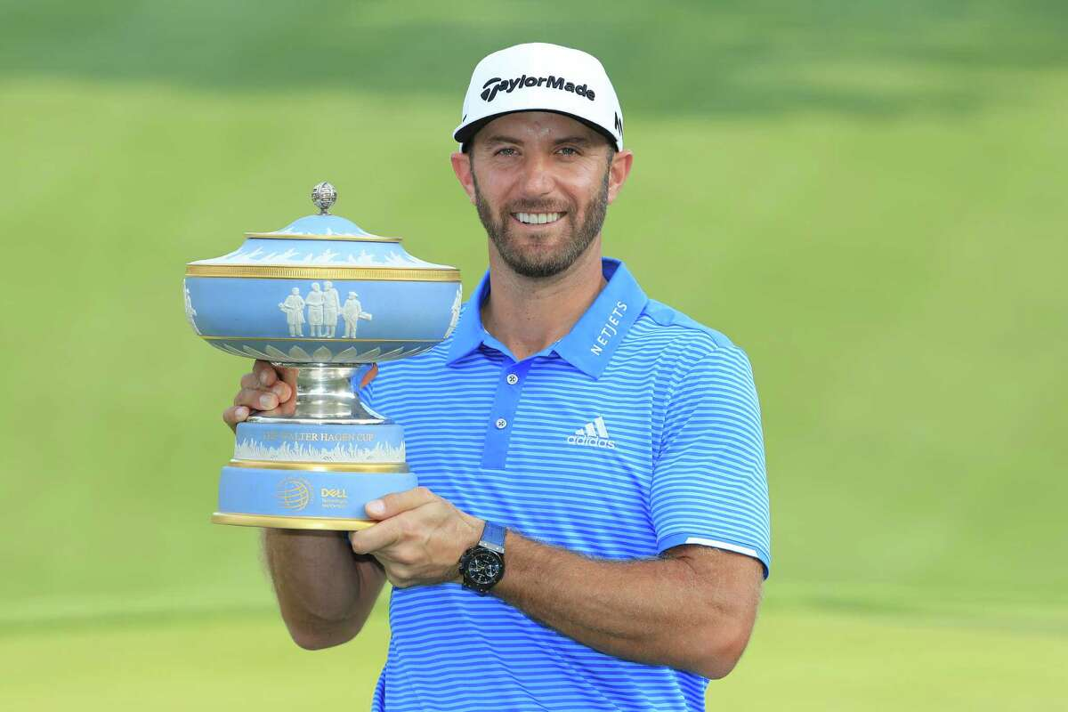 AUSTIN, TX - MARCH 26: Dustin Johnson of the USA poses with the trophy after winning the World Golf Championships-Dell Technologies Match Play at the Austin Country Club on March 26, 2017 in Austin, Texas. (Photo by Richard Heathcote/Getty Images) ORG XMIT: 686971373