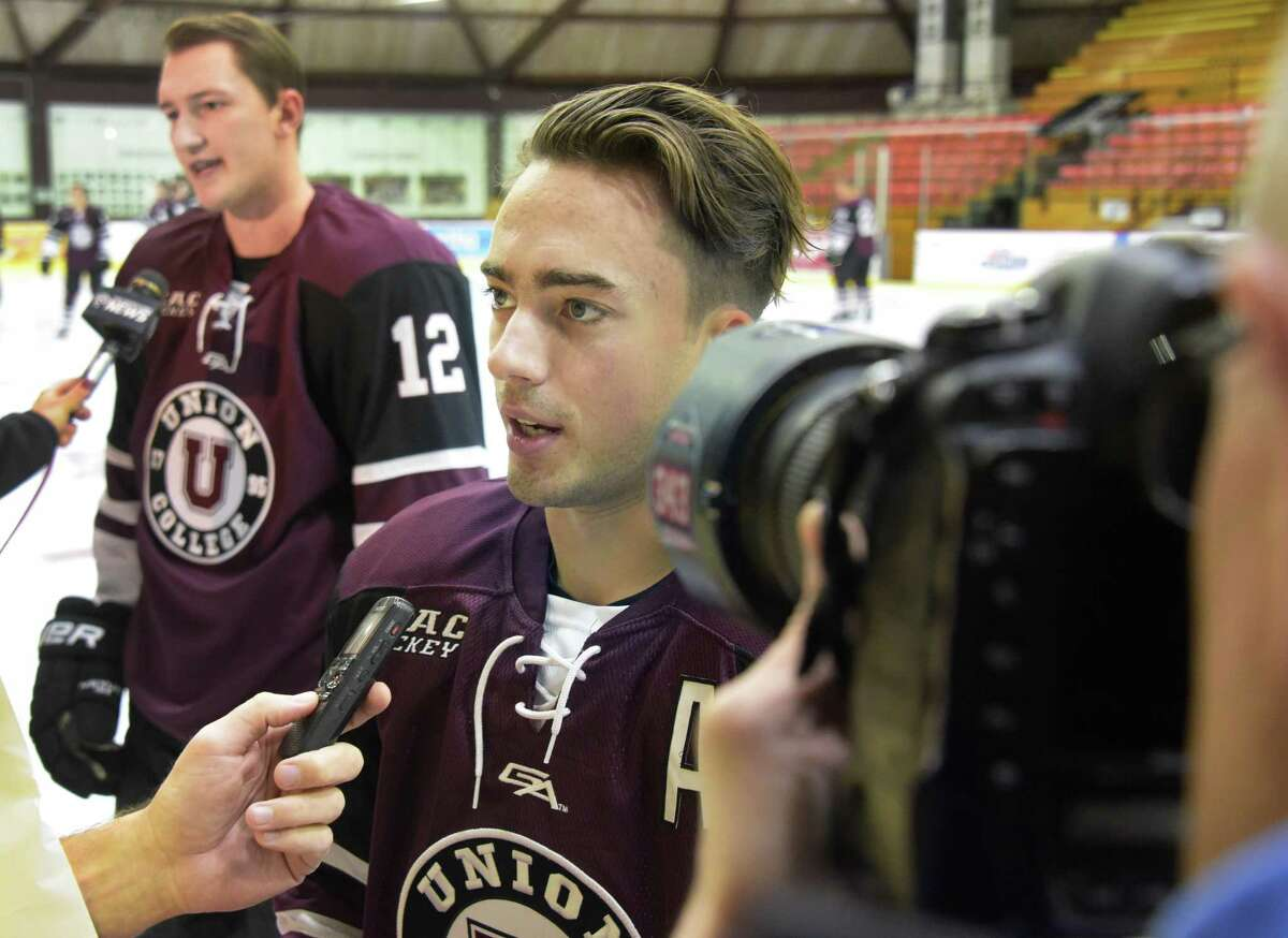 Jeff Taylor, center, speaks with reporters during Union College hockey media day Thursday Sept. 29, 2016 in Schenectady, NY. (John Carl D'Annibale / Times Union) ORG XMIT: MER2016102010471071