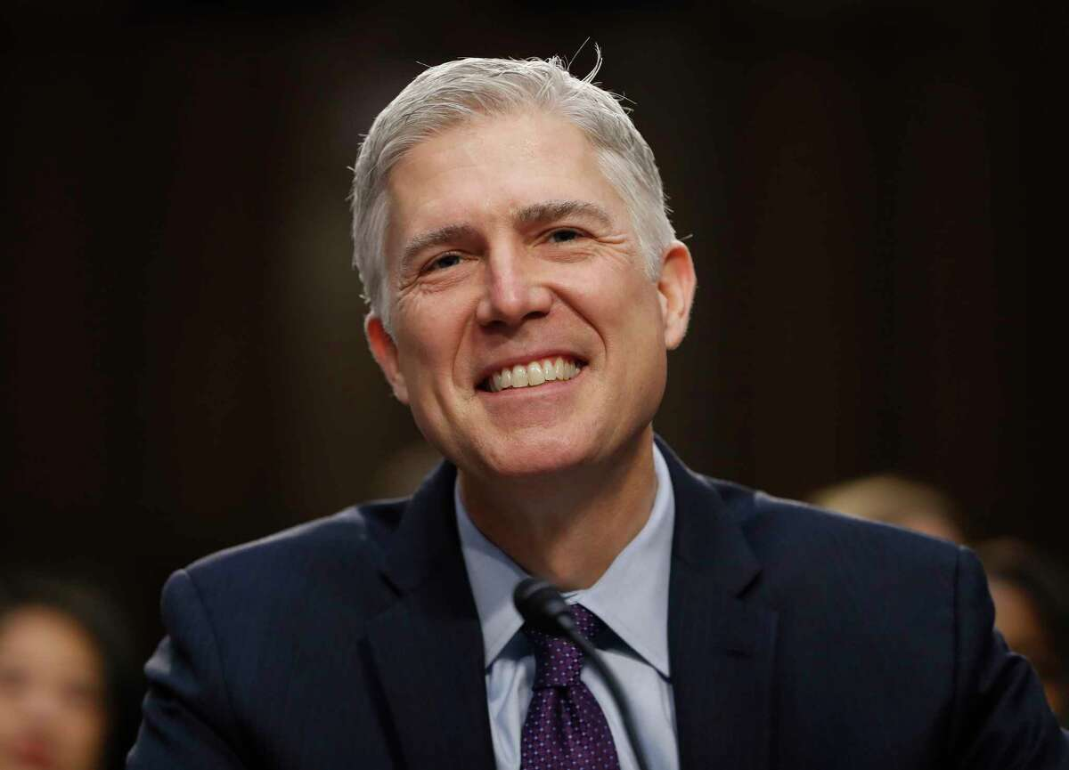 In this March 21, 2017 photo, Supreme Court Justice nominee Neil Gorsuch smiles on Capitol Hill in Washington, during his confirmation hearing before the Senate Judiciary Committee. (AP Photo/Pablo Martinez Monsivais) ORG XMIT: WX104