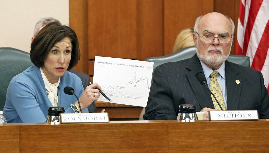 Senator Lois Kolkhorst presents graphic history of revenues with Senator Robert Nichols observing as State Comptroller Glenn Hegar testifies at the Senate Finance Committee meeting at the State Capitol on January 26, 2016. Photo: TOM REEL, STAFF / SAN ANTONIO EXPRESS-NEWS / 2016 SAN ANTONIO EXPRESS-NEWS