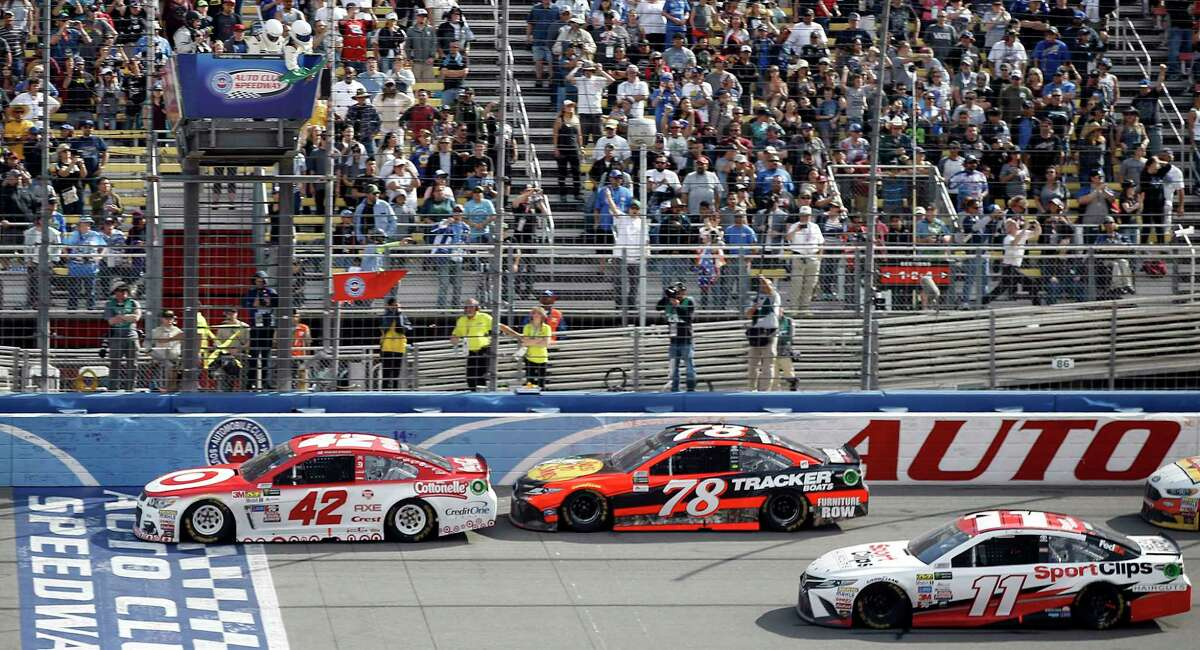 Kyle Larson (42) leads in front of Martin Truex Jr. (78) and Denny Hamlin (11) in final laps of the NASCAR Cup Series auto race at Auto Club Speedway in Fontana, Calif., Sunday, March 26, 2017. Larson won the race. (AP Photo/Alex Gallardo) ORG XMIT: CAAG112