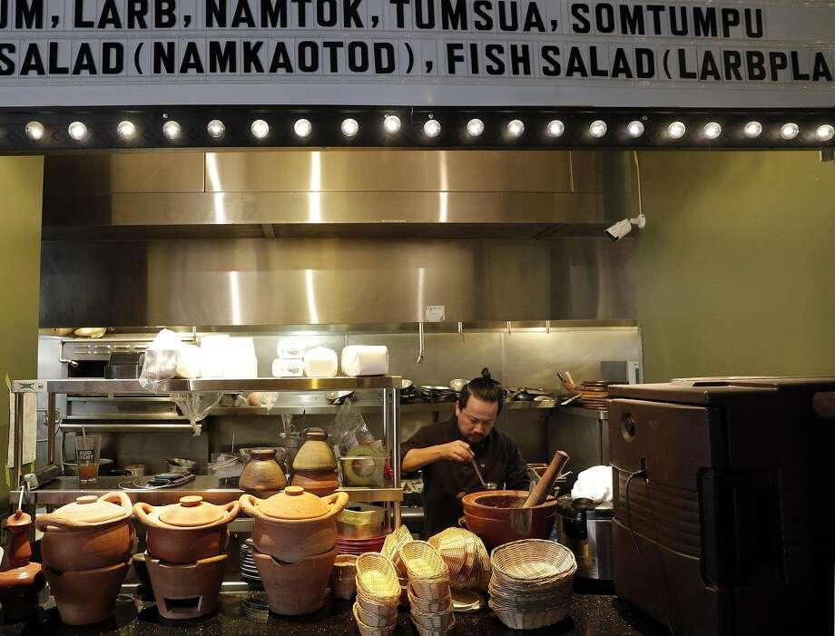 Chef Nutnawat Aukcarapasutanun, a.k.a. Kobe,serves up some food behind the counter. Photo: Carlos Avila Gonzalez, The Chronicle