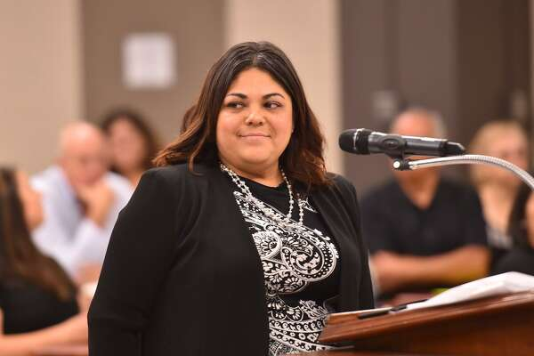 SAISD board candidate Christina Martinez smiles before giving her presentation during Monday evening's SAISD board meeting to replace Olga Hernandez. Hernandez resigned with two years remaining of her term after being indicted on a fraud charge.