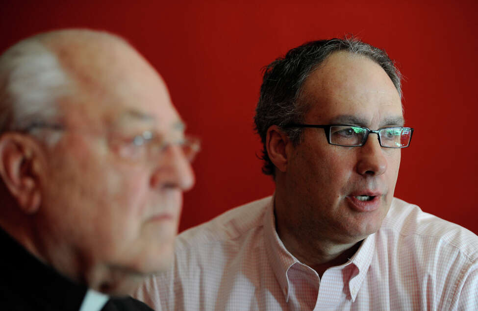 Former Congressman John Sweeney(r) spoke to the Times Union March 4, 2011 at the offices of Father Peter Young(l) in Albany, New York. (Skip Dickstein / Times Union)