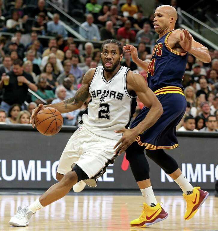 San Antonio Spurs' Kawhi Leonard drives around Cleveland Cavaliers' Richard Jefferson during first half action Monday March 27, 2017 at the AT&T Center.