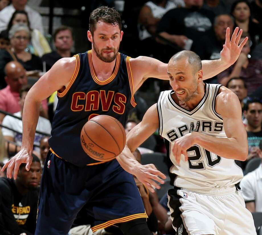 Cleveland Cavaliers' Kevin Love and San Antonio Spurs' Manu Ginobili chase after a loose ball during second half action Monday March 27, 2017 at the AT&T Center. The Spurs won 103-74. Photo: Edward A. Ornelas, Staff / San Antonio Express-News / © 2017 San Antonio Express-News