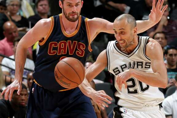 Cleveland Cavaliers' Kevin Love and San Antonio Spurs' Manu Ginobili chase after a loose ball during second half action Monday March 27, 2017 at the AT&T Center. The Spurs won 103-74.