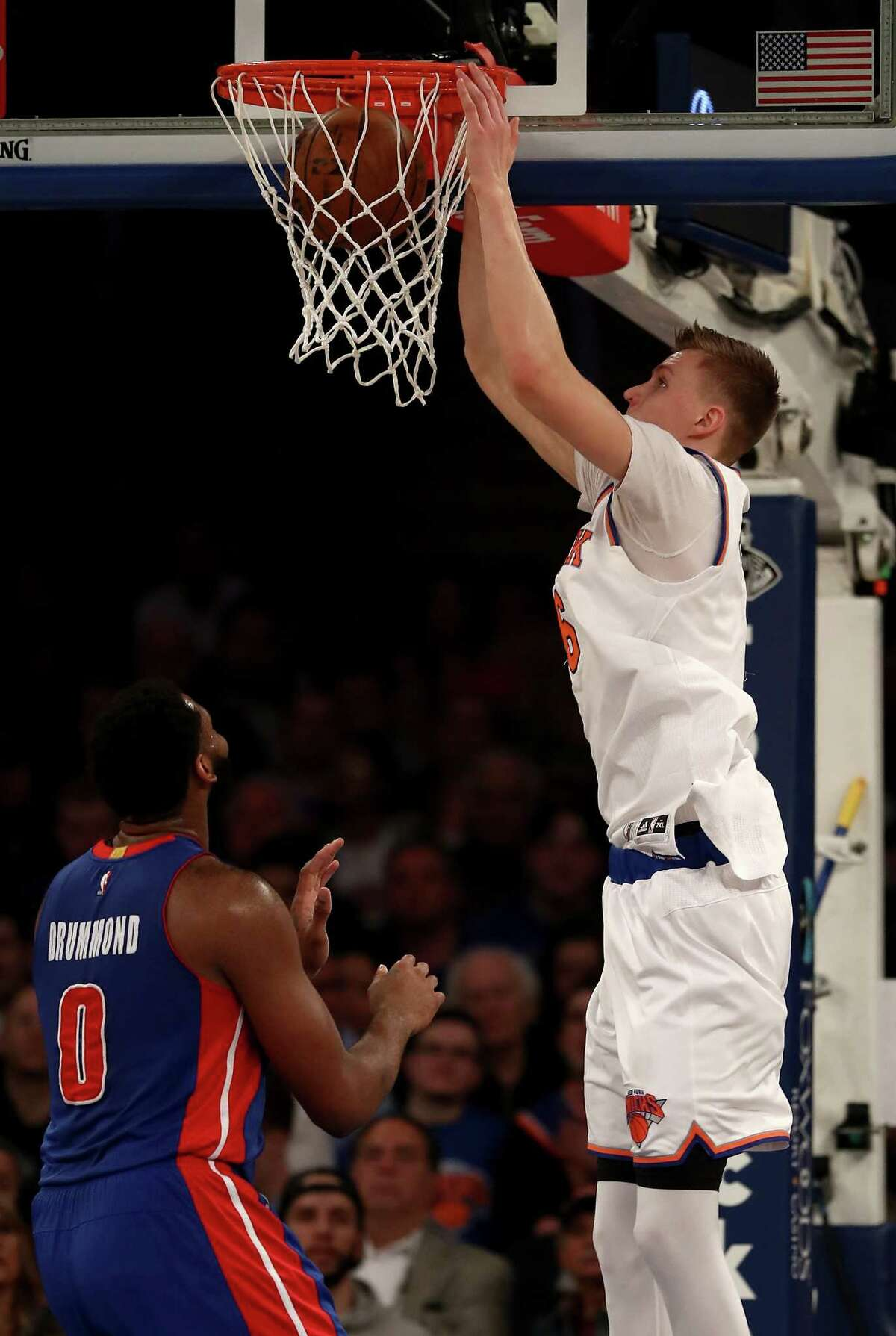 NEW YORK, NY - MARCH 27: Kristaps Porzingis #6 of the New York Knicks dunks as Andre Drummond #0 of the Detroit Pistons defends at Madison Square Garden on March 27, 2017 in New York City. NOTE TO USER: User expressly acknowledges and agrees that, by downloading and or using this Photograph, user is consenting to the terms and conditions of the Getty Images License Agreement (Photo by Elsa/Getty Images) ORG XMIT: 662357335