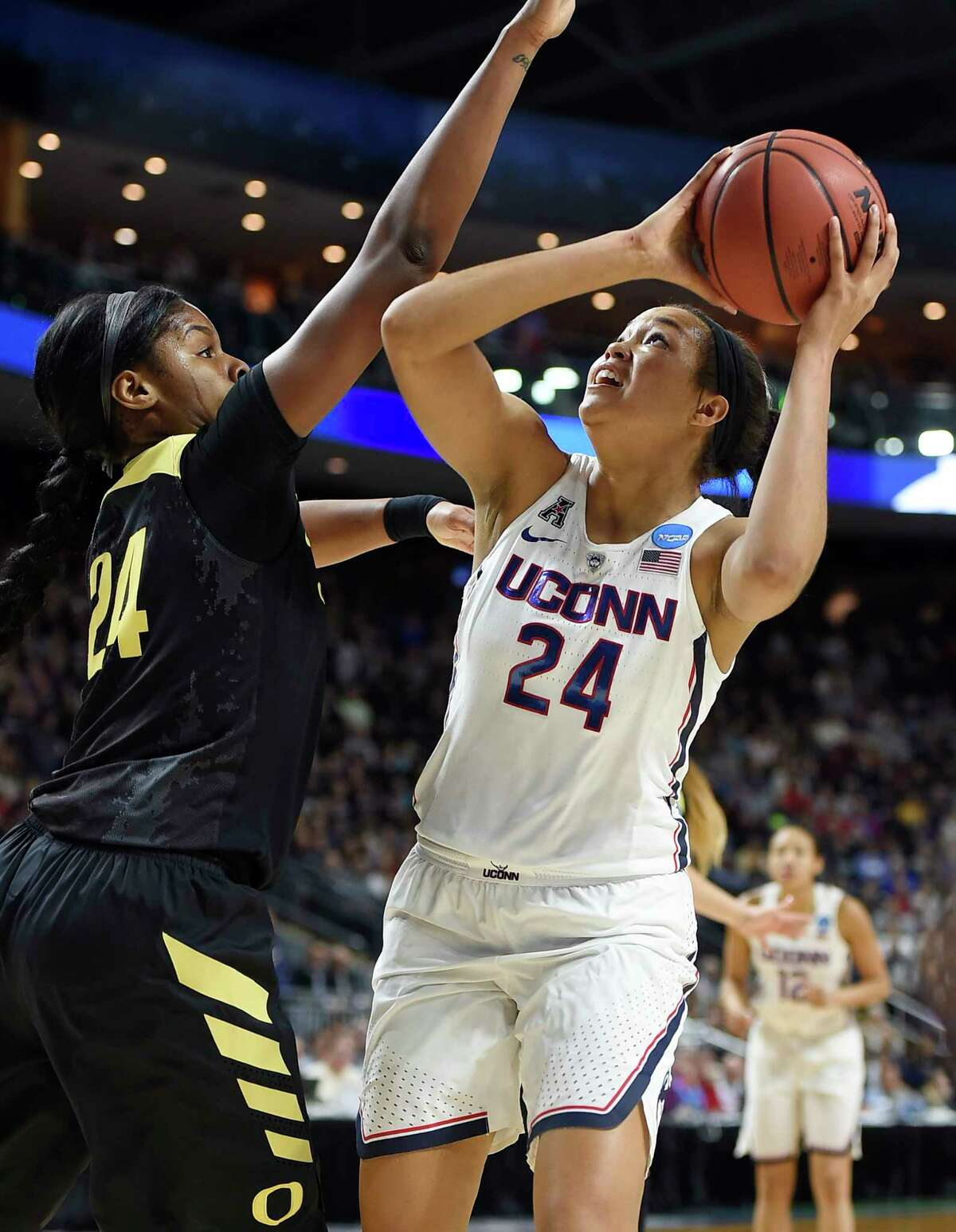 Connecticut's Napheesa Collier, right, shoots as Oregon's Ruthy Hebard, left, defends, during the first half of a regional final game in the NCAA women's college basketball tournament, Monday, March 27, 2017, in Bridgeport, Conn. (AP Photo/Jessica Hill) ORG XMIT: CTJH103