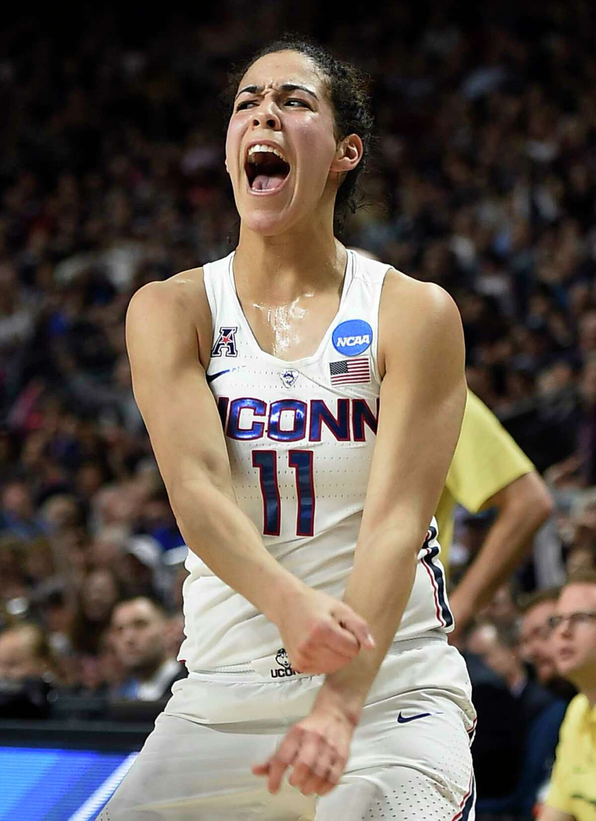 Connecticut's Kia Nurse reacts after hitting a 3-point basket during the first half of a regional final game against Oregon in the NCAA women's college basketball tournament, Monday, March 27, 2017, in Bridgeport, Conn. (AP Photo/Jessica Hill) ORG XMIT: CTJH101