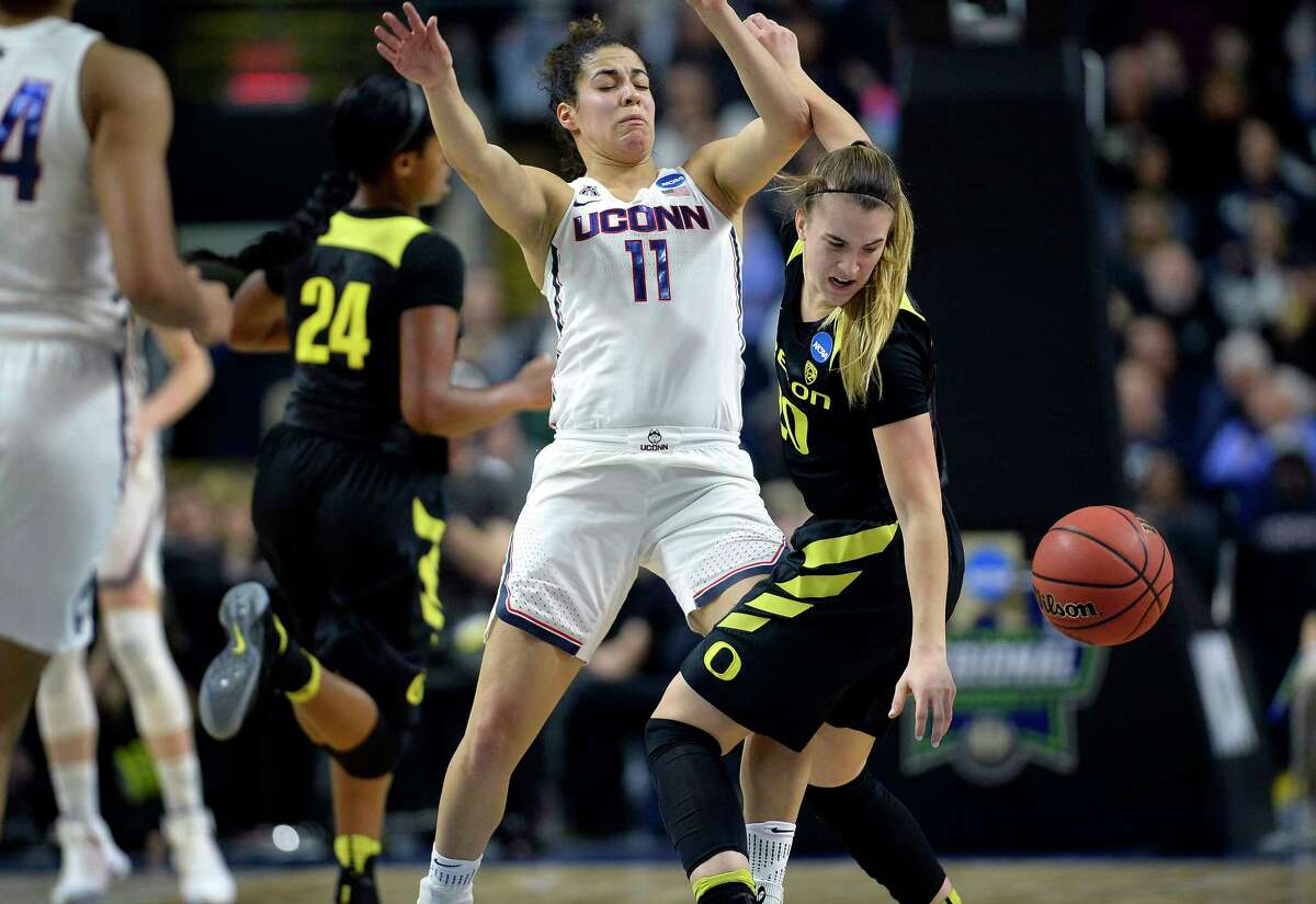 Oregon's Sabrina Ionescu, right, tries to gather the ball after running into the defense by Connecticut's Kia Nurse during the first half of a regional final game in the NCAA women's college basketball tournament, Monday, March 27, 2017, in Bridgeport, Conn. (AP Photo/Jessica Hill) ORG XMIT: CTJH201
