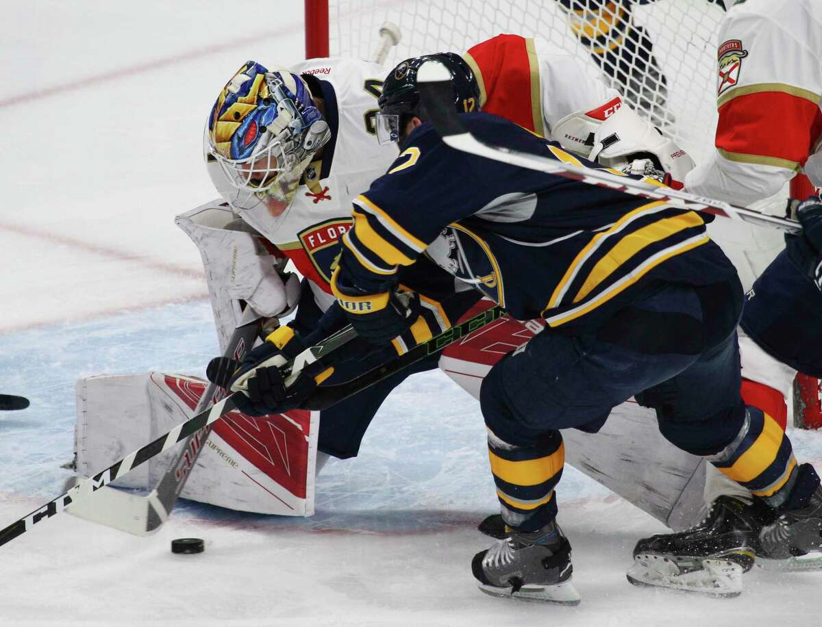 Buffalo Sabres forward Brian Gionta (12) is stopped by Florida Panthers goalie James Reimer (34) during the first period of an NHL hockey game, Monday, March 27, 2017, in Buffalo, N.Y. (AP Photo/Jeffrey T. Barnes) ORG XMIT: NYJB104