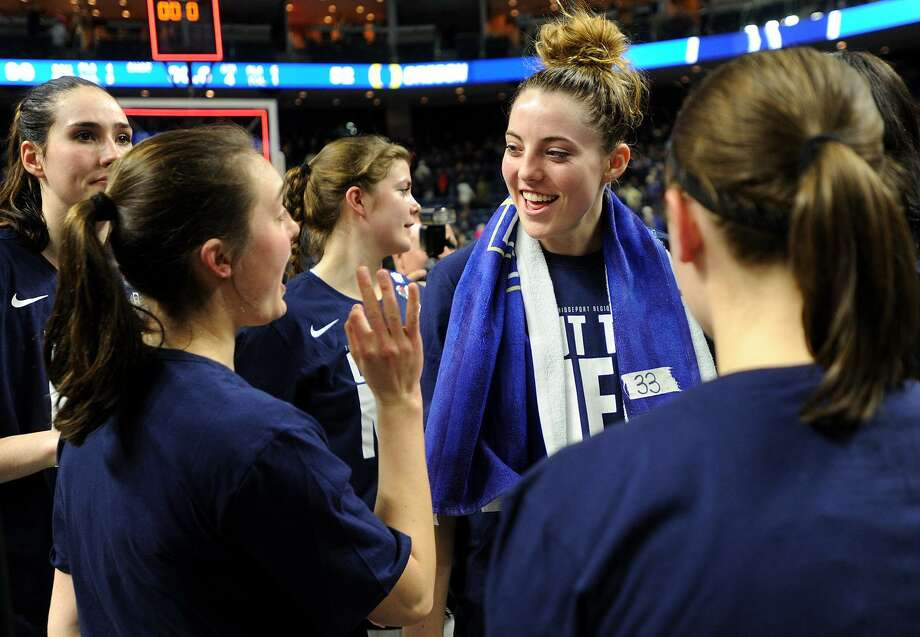 UConn's Katie Lou Samuelson, center, is all smiles following her team's victory over Oregon in the NCAA Women's Basketball Regional Final game at the Webster Bank Arena in Bridgeport, Conn. on Monday, March 27, 2017. Photo: Brian A. Pounds / Hearst Connecticut Media / Connecticut Post