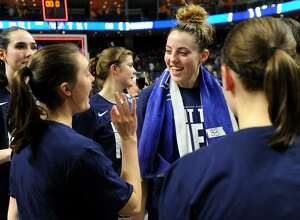 UConn's Katie Lou Samuelson, center, is all smiles following her team's victory over Oregon in the NCAA Women's Basketball Regional Final game at the Webster Bank Arena in Bridgeport, Conn. on Monday, March 27, 2017.