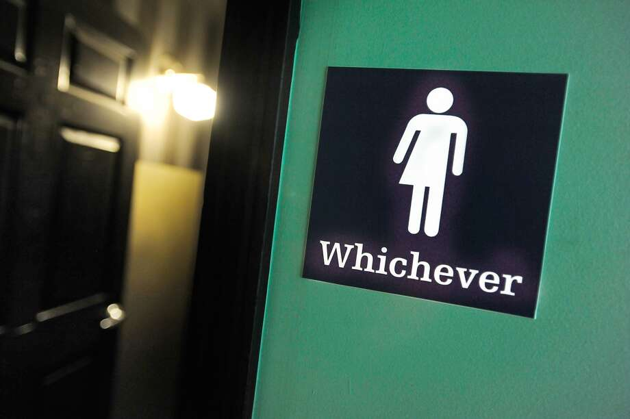 DURHAM, NC - MAY 11: A gender neutral sign is posted outside a bathrooms at Oval Park Grill on May 11, 2016 in Durham, North Carolina. Debate over transgender bathroom access spreads nationwide as the U.S. Department of Justice countersues North Carolina Governor Pat McCrory from enforcing the provisions of House Bill 2 (HB2) that dictate what bathrooms transgender individuals can use. (Photo by Sara D. Davis/Getty Images) Photo: Sara D. Davis, Getty Images