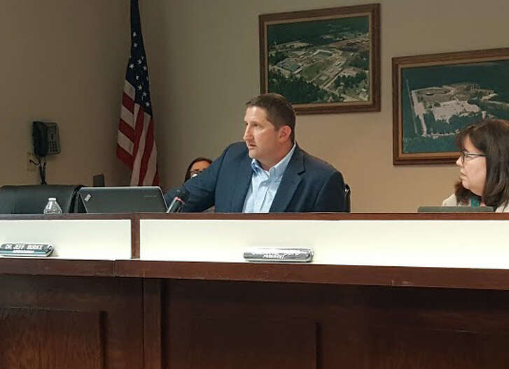 Splendora ISD Superintendent Jeff Burke discusses community-based assessment during the school board meeting March 20.