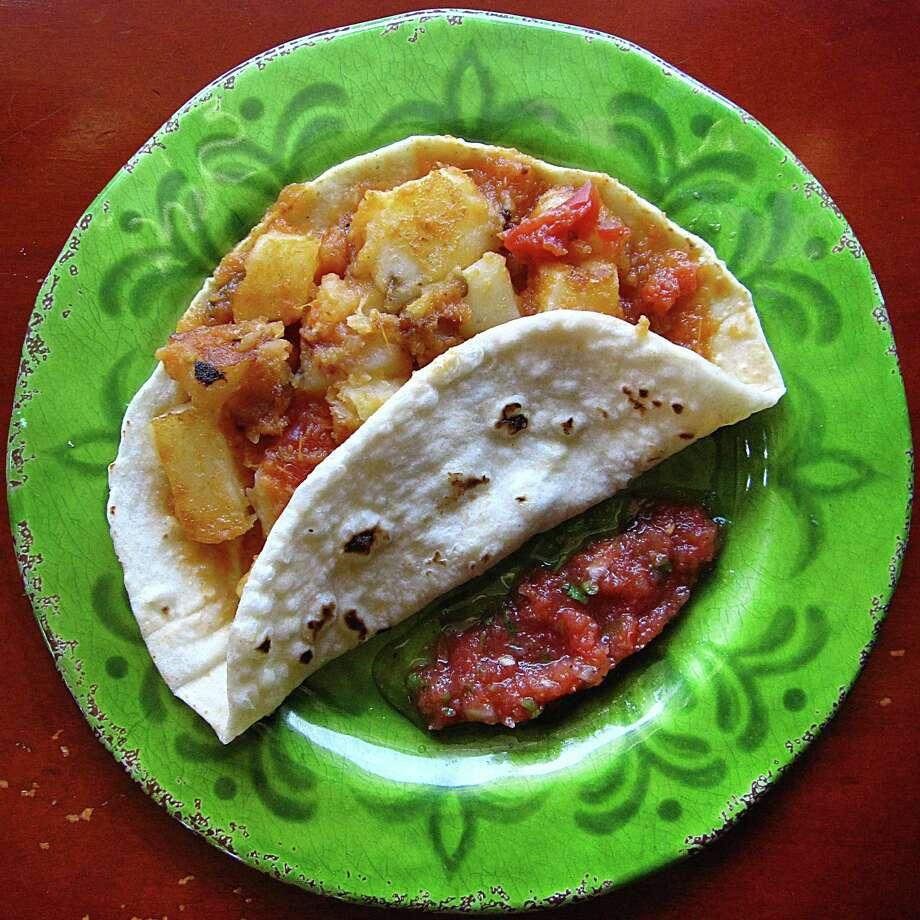 Papas rancheras taco on a handmade flour tortilla from Erick's Tacos on Nacogdoches Road. Photo: Mike Sutter /San Antonio Express-News