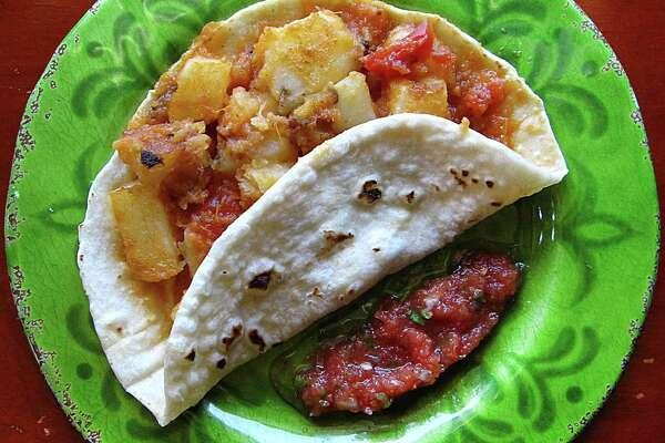 Papas rancheras taco on a handmade flour tortilla from Erick's Tacos on Nacogdoches Road.