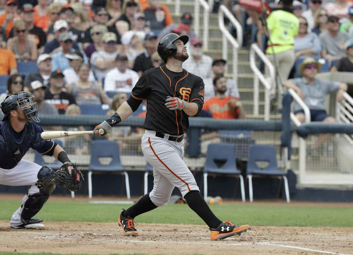 San Francisco Giants' Brandon Belt hits during a spring training baseball game against the Milwaukee Brewers, Wednesday, March 22, 2017, in Phoenix. (AP Photo/Darron Cummings)