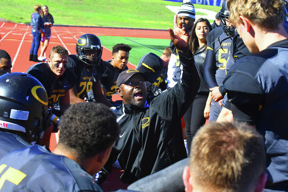 Klein Oak's Jason Glenn, then the defensive coordinator and acting head coach, rallies the troops after last season's 39-22 loss to Round Rock in the area round of the playoffs. He looked every bit the head coach during the matchup, presaging the offseason promotion to come. Photo: Tony Gaines / HCN