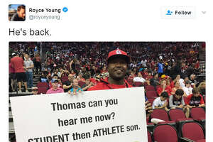 This unidentified man's signs with advice to his son have generated comment on social media, although not everyone approves.