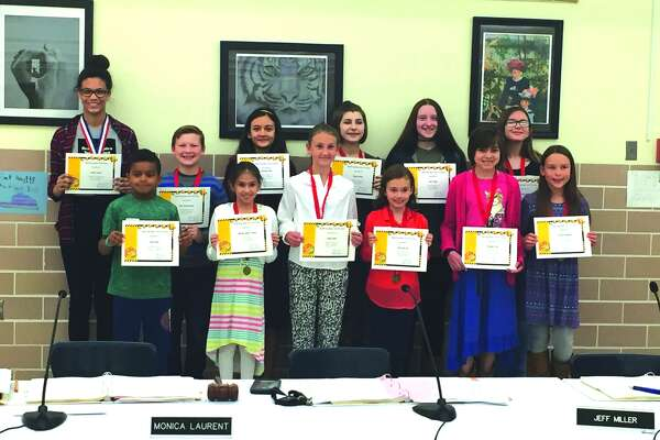 District 7s top spellers were recognized during the District 7 Board of Education Meeting Monday night.  These students participated in the district's ninth annual district 7 spelling bee. Koen Riney from Worden Elementary; Kaitlyn Lemanski, Sydney Andrews and Margaret Paty from Cassens Elementary; Gabriella Hill and Kaitlyn DeVries from Columbus Elementary; Allison Mills, Merissa Quart-Ackad and Max Waltenberger from Woodland Elementary; Rachel Mueller, Andy Byer, Lexi Trimm, Dhruv Mathur, and Gabe Moss from Liberty Middle School; Linnea Turner, Meghan Wilkerson, Alicia Diaz, Emma Krumm, and Madison Deck from Lincoln Middle School.  Koen Riley (front row far left) was the runner up and Linnea Turner (back row far left) was the District 7 champion.  Turner, along with six other D7 spellers, competed in the St. Louis regional competition at McKendree University.  Turner advanced to the final round of the competition.