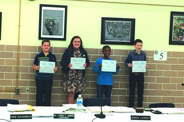 Geography Bee building winners were recognized during the Edwardsville District 7 Board of Education meeting Monday night.  Student winners included (L to R) Jackson Ward (Worden), Graham Cobb-Gulledge (Woodland), Jeremiah Harmon (Columbus) and Benjamin Hyten (Lincoln).  Not pictured: Seth Blakemore (Liberty) and William Hunt (Cassens)