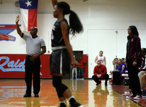 A referee watches the game during a girls' basketball game between Lumberton and Central in Lumberton on Tuesday evening.  Photo taken Tuesday 1/17/17 Ryan Pelham/The Enterprise