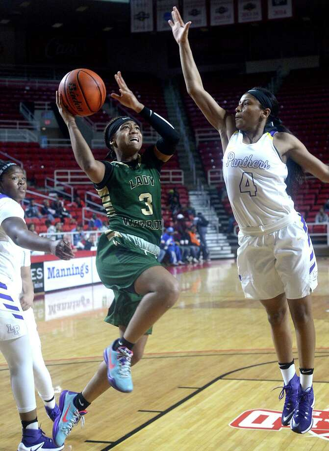 Legacy Christian Academy's Alexis Morris puts up her shot against the efforts of Lufkin's Ivie Massie as they vie for the YMBL trophy during Saturday's tournament finals at the Montagne Center. Photo taken Saturday, December 3, 2016 Kim Brent/The Enterprise Photo: Kim Brent / Beaumont Enterprise