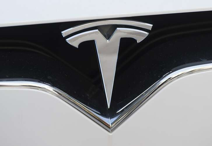 (FILES) This file photo taken on December 20, 2016 shows the Tesla logo  in Washington, DC. Wall Street stocks were steady in early trading on March 28, 2017 with shares of Tesla boosted by news that China's Tencent Holdings took a stake in the US electric car maker. About 15 minutes into trading, the Dow Jones Industrial Average stood at 20,542.07, down less than 0.1 percent. The Dow has fallen the last eight sessions and another loss at the closing bell would mean the first nine-day losing streak since 1978.  / AFP PHOTO / SAUL LOEBSAUL LOEB/AFP/Getty Images