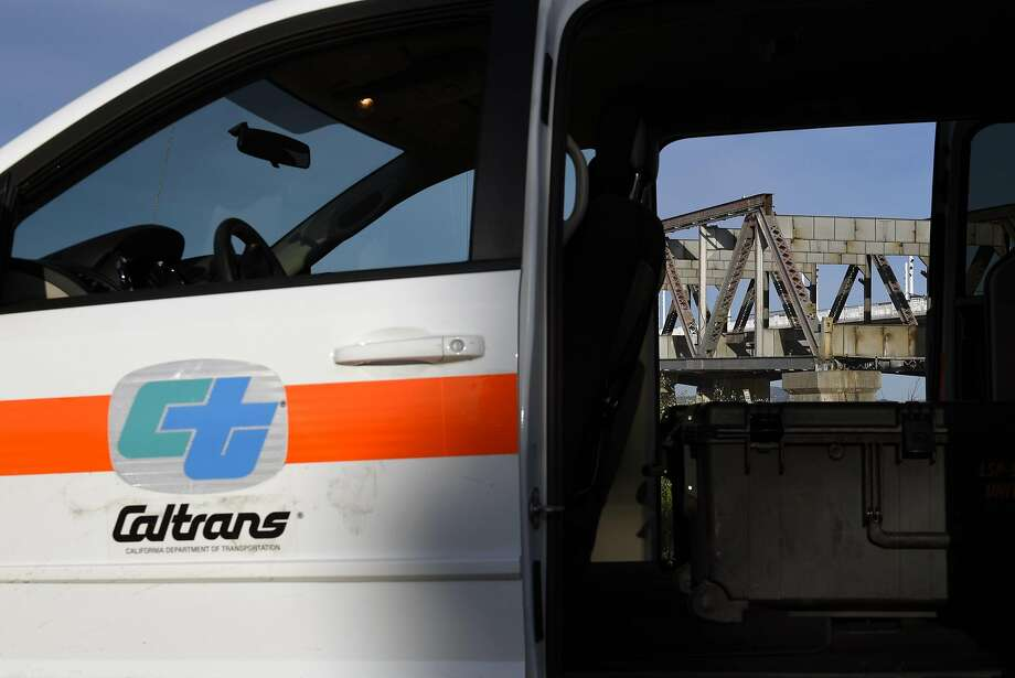 In this file photo, the final steel truss span of the Old Bay Bridge is seen through the open door of a CalTrans vehicle in Oakland, CA, on Tuesday March 28, 2017. Photo: Michael Short, Special To The Chronicle