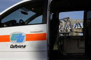 The final steel truss span of the Old Bay Bridge is seen through the open door of a CalTrans vehicle in Oakland, CA, on Tuesday March 28, 2017.