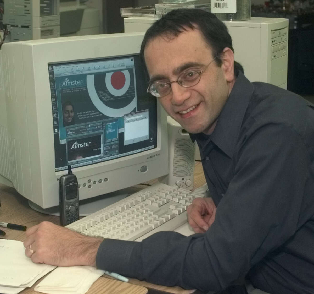 ADVANCE FOR WEEKEND, DEC. 30-31-- John Deep, a founder of Aimster, poses with the Aimster program at Aimster offices in Albany, N.Y., Thursday, Dec. 21, 2000. The program enables users to exchange files using instant messaging.