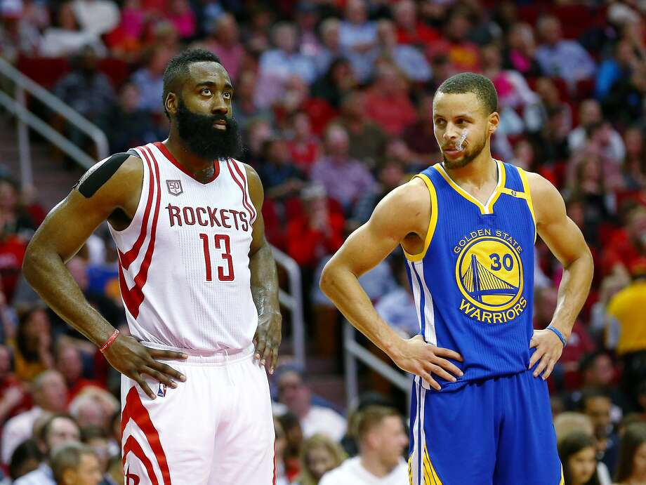 Golden State Warriors guard Stephen Curry (30) glances in the direction of Houston Rockets guard James Harden (13) during a break in play during the third quarter of an NBA game at the Toyota Center Friday, Jan. 20, 2017, in Houston. Photo: Jon Shapley, Houston Chronicle