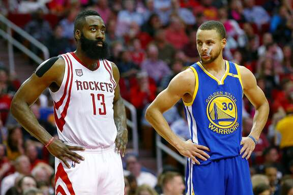 Golden State Warriors guard Stephen Curry (30) glances in the direction of Houston Rockets guard James Harden (13) during a break in play during the third quarter of an NBA game at the Toyota Center Friday, Jan. 20, 2017, in Houston. ( Jon Shapley / Houston Chronicle )
