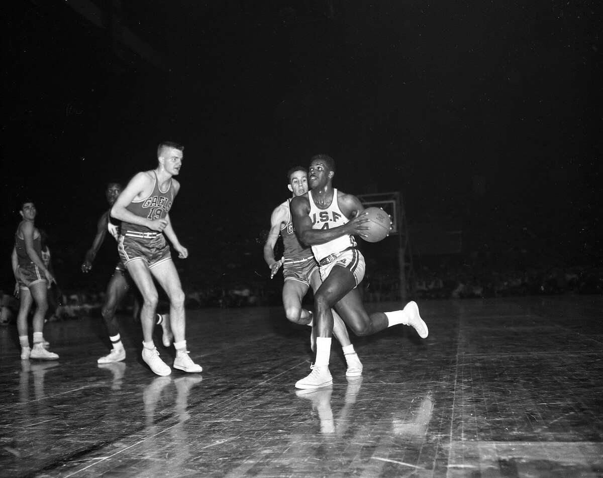 USF's K.C. Jones drives during a game against St. Mary's at the Cow Palace in 1956. The Dons' season ended with an NCAA title.