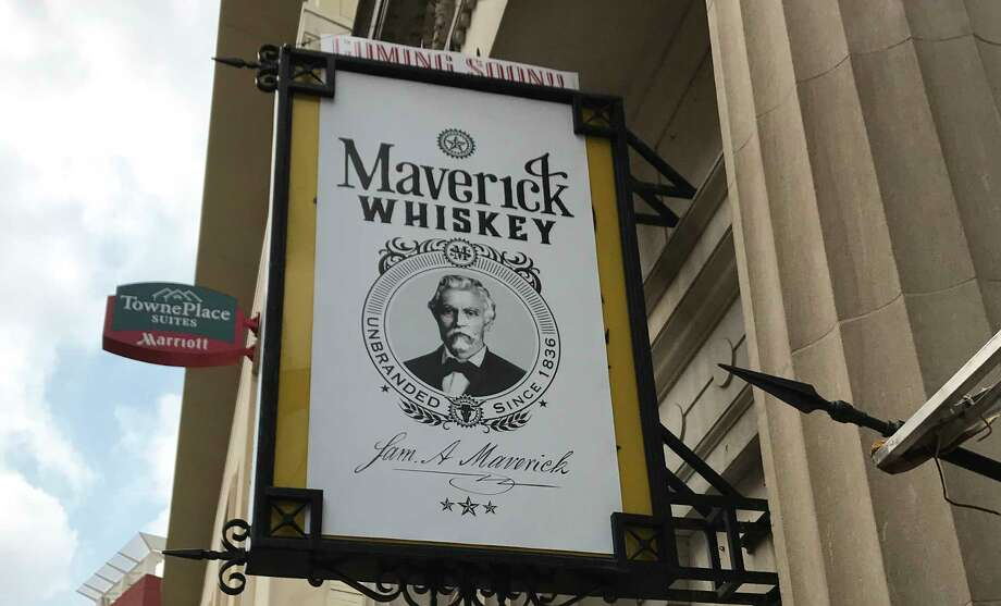 A sign tantalizes downtowners with the news that Maverick Whiskey is coming soon. The sign hangs over the old Antiques on Broadway space, right next door to the famous Paris Hatters shop. Photo: Emily Spicer, San Antonio Express-News
