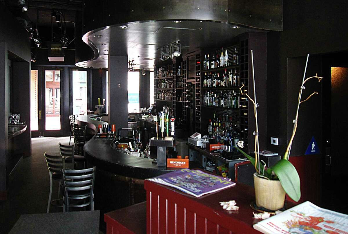 The bar is still stocked with liquor bottles, and the bar furniture is still in place after the lockout at Swig Martini Bar.