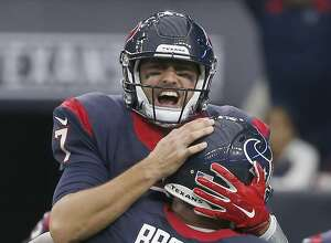 HOUSTON, TX - NOVEMBER 29: Brian Hoyer #7 and Brandon Brooks #79 of the Houston Texans celebrates a touchdown against the New Orleans Saints in the third quarter on November 29, 2015 at NRG Stadium in Houston, Texas. (Photo by Scott Halleran/Getty Images)