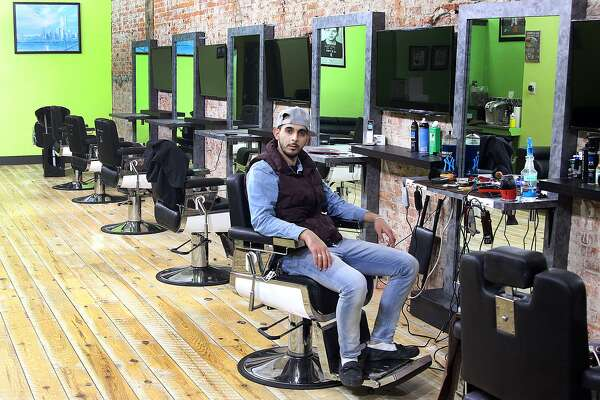 Co-owner Sam Karasneh sits in CutZone II, which opened earlier this month at 255 Main St. in downtown Danbury on Tuesday, March 28, 2017.