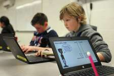 Sixth grader Filip Stefaniak works on his math lesson as part of the Teach-to-One program Tuesday, March 21, 2017, at Nathan Hale Middle School in Norwalk, Conn. The program is an individualized mathematics learning program which was implemented at the beginning of the school year as a part of the Phase I middle school redesign and has yielded overwhelmingly positive results.