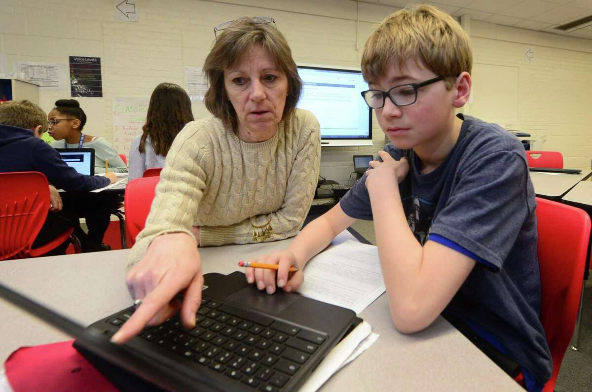 Sixth grade math teacher Kathy Healy instructs her student, Tomas, Norris-Oliva, as part of the Teach-to-One program Tuesday, March, 21, 2017, at Nathan Hale Middle School in Norwalk, Conn. The program is an individualized mathematics learning program which was implemented at the beginning of the school year as a part of the Phase I middle school redesign and has yielded overwhelmingly positive results.