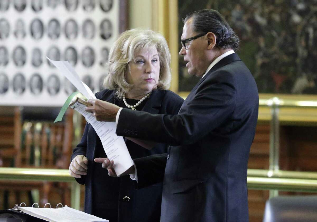 Senators Jane Nelson and Senator Jose Rodriguez go over the legislation as the Texas Senate takes up its budget proposal on the floor in the Capitol on March 28, 2017.